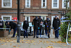 © Licensed to London News Pictures. 12/10/2020. London, UK. Police search team carrying out the search within the crime scene in Homerton in Hackney, north London following triple shooting. Officers were called at 22:48hrs on Sunday, 11 October, to reports of a shooting on Homerton High Road in Hackney, and found three people with gunshot injuries. Two men, aged 60 and 32, were taken to hospital with non life-threatening/life-changing injuries. A third man, aged 24, was taken to hospital and remains in a life-threatening condition. Photo credit: Dinendra Haria/LNP