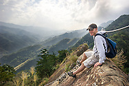A hiker about to descend the very long rope ladder on Wu Liao Jian Hiking Trail.