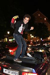 23.06.2010, Leopoldstrasse Schwabing, Muenchen, GER, FIFA Worldcup, Fanfeier nach Ghana vs Deutschland,  im Bild Fan auf autokofferaum, EXPA Pictures © 2010, PhotoCredit: EXPA/ nph/  Straubmeier