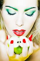 beautiful caucasian woman portrait holding apple studio