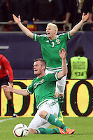 ROMANIA, Bucharest: Northern Ireland's Ryan McGivern (up) and  Chris Brunt (down) react during the Euro 2016 Group F qualifying football match Romania vs Northern Ireland in Bucharest, Romania on November 14, 2014.