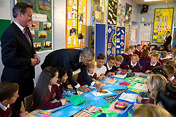 President Barack Obama and Prime Minister David Cameron of the United Kingdom visit with students in a classroom at Mount Pleasant Primary School in Newport, Wales, Sept. 4, 2014. (Official White House Photo by Pete Souza)<br /> <br /> This official White House photograph is being made available only for publication by news organizations and/or for personal use printing by the subject(s) of the photograph. The photograph may not be manipulated in any way and may not be used in commercial or political materials, advertisements, emails, products, promotions that in any way suggests approval or endorsement of the President, the First Family, or the White House.
