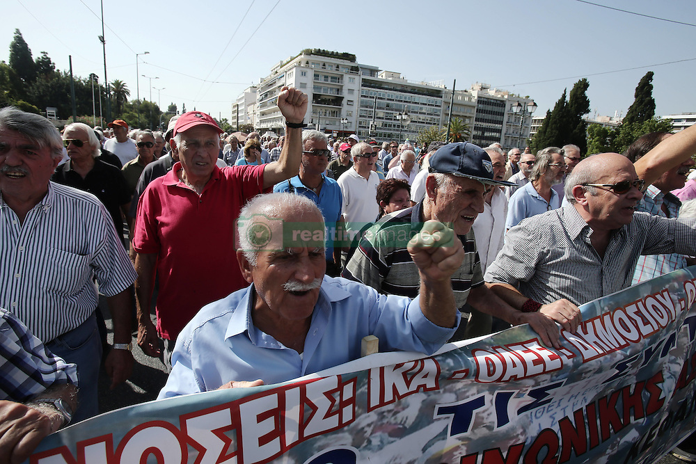October 3, 2016 - Athens, Greece - Pensioners shout slogans against the government, marching in central Athens, on Monday October 3, 2016. Greek pensioners taking part at a protest march against pension cuts, demanted meeting with Prime minister but were stoped with tear gas by riot police close to the government's headquarters. (Credit Image: © Panayiotis Tzamaros/NurPhoto via ZUMA Press)