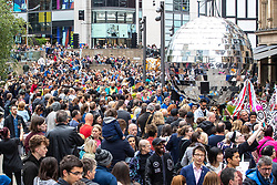 © Licensed to London News Pictures . 17/06/2018. Manchester , UK . Crowds fill Exchange Square to watch as a giant disco ball passes through . The 2018 Manchester Day parade , celebrating Manchester's cultural and social life and diversity, passes through Manchester City Centre . Photo credit : Joel Goodman/LNP