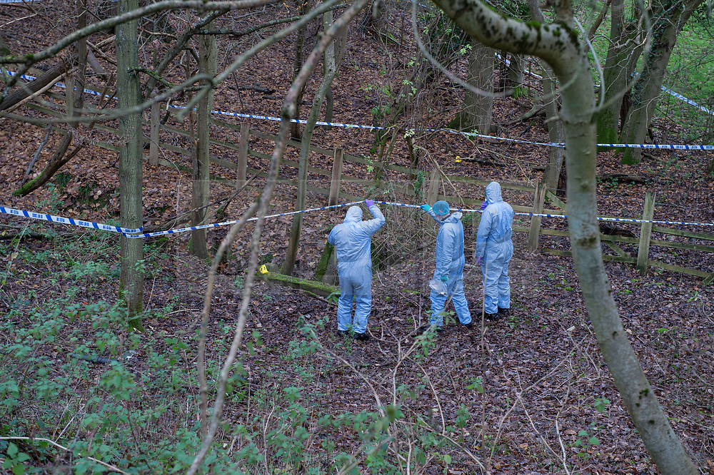 FILE IMAGE © Licensed to London News Pictures. 07/12/2019. Beaconsfield, UK. Forensic investigators hold up police cordon tape and look at a concrete pit indicated with an evidence identification marker during an initial inspection of the search site as the Metropolitan Police Service confirm they are searching woodland in Beaconsfield, Buckinghamshire in connection with the disappearance and murder of Mohammed 'Shah' Subhani. Police have been in the area conducting operations on Hedgerley Lane since Thursday 5th December 2019 and are combing wooded area with specialist officers assisted by specialist search dogs. Photo credit: Peter Manning/LNP
