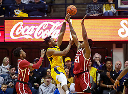 Feb 2, 2019; Morgantown, WV, USA; West Virginia Mountaineers forward Derek Culver (1) shoots over Oklahoma Sooners forward Kristian Doolittle (21) during the first half at WVU Coliseum. Mandatory Credit: Ben Queen-USA TODAY Sports
