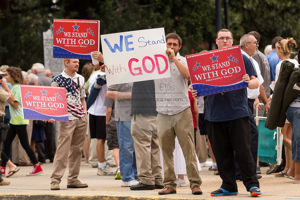 """Evangelical Christians hold signs as they gather for the """"Stand With God"""" rally  August 29, 2015 in Columbia, SC. Thousands of conservative christians gathered at the State House to rally against gay marriage and listen to GOP presidential candidates Gov. Rick Perry and Sen. Ted Cruz speak."""