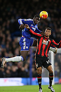 Kurt Zouma of Chelsea heads the ball over Joshua King of Bournemouth. Barclays Premier league match, Chelsea v AFC Bournemouth at Stamford Bridge in London on Saturday 5th December 2015.<br /> pic by John Patrick Fletcher, Andrew Orchard sports photography.