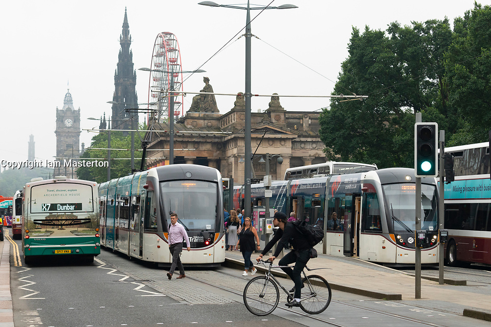View of buses and trams on Princes Street in Edinburgh, Scotland UK