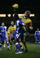 Photo: Barry Bland.<br />Norwich City v Cardiff City. Coca Cola Championship.<br />01/11/2005.<br />Calum Davenport and Cameron Jerome.