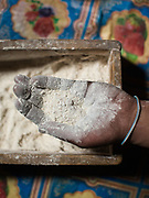 Flour held in a hand, to make pancakes. At the house of Momin Shah. In Shimshal, one of the remotest village in the Karakoram mountains, and the highest settlement in the Hunza and Gojal region.