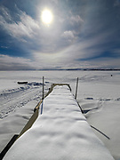 Magic Reservoir Snow Covered Dock on a cold and sunny winters day in South Central Idaho.  Licensing and Open Edition Prints.