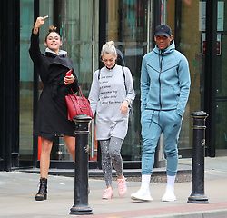 Manchester United's Anthony Martial and girlfriend Melanie D Cruz Pires leave All Star Lanes Bowling Alley in Manchester city centre early on Sunday evening after dining with a friend and having a game on the bowling lanes