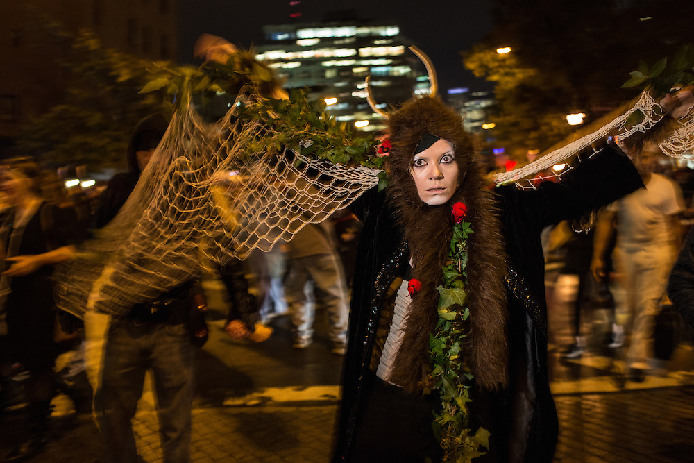 New York, NY, October 31, 2013. A woman wearing a costume with netting, fur, horns and leaves in New York's Greenwich Village Halloween Parade.