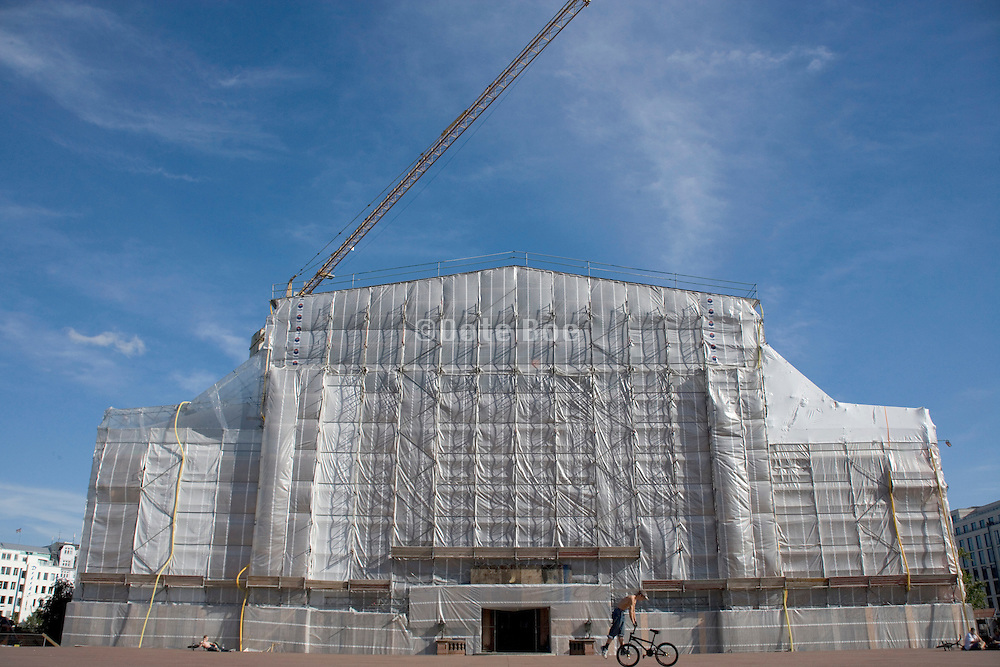 large building fully wrapped up for a renovation Germany Hamburg