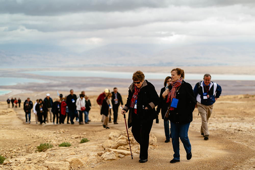 American Evangelical Christian tourists and pilgrims, led by Former Arkansas Governor Mike Huckabee (not pictured), are seen as they visit the ancient hilltop fortress of Masada in the Judean desert in Israel, on February 19, 2015. The ancient ruined desert fortress on a wind-swept plateau overlooking the Dead Sea is seen by many as an emblem of Israel's fighting spirit, it is believed to be the place where close to a thousand Jewish rebels killed themselves and each other about two millennia ago, rather than surrender and fall into slavery under the Romans.