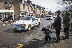 Ford the dog who belonged to Craig Melville watches as a convoy of cars leads the funeral cortege of Craig Melville through the High Street in Alness, Sutherland. The car-loving 16-year-old died in a car crash on March 27, 2021. Picture date: Friday April 9, 2021.