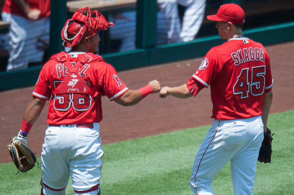 The Angels' Carlos Perez and Tyler Skaggs celebrate after Yunel Escobar argues after the fourth inning against the Boston Red Sox at Angel Stadium on Sunday.<br /> <br /> ///ADDITIONAL INFO:   <br /> <br /> angels.0730.kjs  ---  Photo by KEVIN SULLIVAN / Orange County Register  -- 7/31/16<br /> <br /> The Los Angeles Angels take on the Boston Red Sox at Angel Stadium.