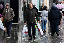 © Licensed to London News Pictures. 03/11/2020. St Helens, UK. People brave the rain in St Helens to do some shopping. Photo credit: Kerry Elsworth/LNP