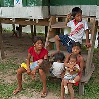 Yanayacu Indian children sit on steps of a government office in San Juan de Yanayacu village in Peru's Amazon Jungle.