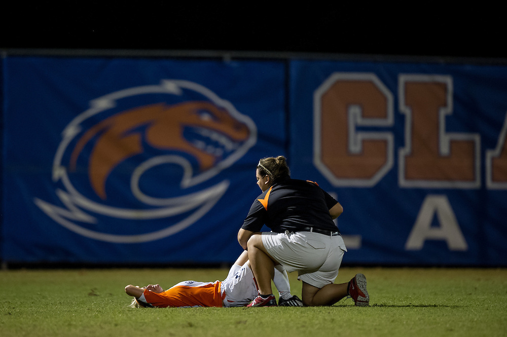 Sep 5, 2013; Morrow, GA, USA; Clayton State women's soccer trainer Stephanie Vasquez helps a player during the game against Tampa at CSU. Both teams tied 3-3 in overtime. Photo by Kevin Liles/kevindliles.com
