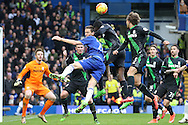 Nemanja Matic of Chelsea jumps  to head the ball over Gianelli Imbula of Stoke City.Barclays Premier league match, Chelsea v Stoke city at Stamford Bridge in London on Saturday 5th March 2016.<br /> pic by John Patrick Fletcher, Andrew Orchard sports photography.