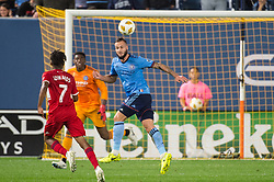 September 26, 2018 - Bronx, New York, US - New York City FC defender MAXIME CHANOT (4) heads the ball away from Chicago Fire midfielder RAHEEM EDWARDS (7) during a regular season match at Yankee Stadium in Bronx, New York.  New York City FC defeats Chicago Fire 2 to 0 (Credit Image: © Mark Smith/ZUMA Wire)