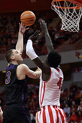 """17 February 2018:  Ted Friedman hooks a shot over Daouda """"David"""" Ndiaye during a College mens basketball game between the University of Northern Iowa Panthers and Illinois State Redbirds in Redbird Arena, Normal IL"""