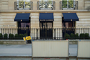 """March, 27th 2020 - Paris, Ile-de-France, France: Paris under confinement, Ralph Lauren, Avenue Montaigne area of high fashion, beauty, accessories, haute couture, all shops closed, in 8th arrondissement, and all public spaces virtually empty to stop the spread of the Coronavirus, during the eleventh day of near total lockdown imposed in France. The President of France, Emmanuel Macron, said the citizens must stay at home for at least 15 days, that has been extended. He said """"We are at war, a public health war, certainly but we are at war, against an invisible and elusive enemy"""". All journeys outside the home unless justified for essential professional or health reasons are outlawed. Anyone flouting the new regulations is fined. Nigel Dickinson"""