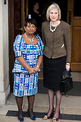 © London News Pictures. 22/04/2013. London, UK.  Foreign Secretary THERESA MAY being greeted by DOREEN LAWRENCE, Mother of Stephen Lawrence as he arrives at a memorial service at St Martins in the Field Church in London marking the 20 anniversary of the murder of Stephen Lawrence. Stephen Lawrence was murdered in a racist attack while waiting for a bus in SOuth London on the evening of 22 April 1993. Photo credit : Ben Cawthra/LNP