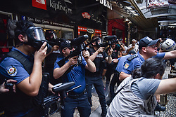 Demonstrators scuffle with the police as they prevent Saturday Mothers' 700th gathering, that meets every week, demanding to know the fate of their missing relatives, claimed to be last seen in the hands of security forces, in central Istanbul, Turkey August 25, 2018. The Saturday Mothers gathered at the same place weekly since 1995 to demand justice for those political activists who disappeared allegedly after being detained by the hands of the state. Police used water cannon and fired tear gas canisters to disperse the protest, an photographer said. Photo by Ä°brahim Mase/DHA/ABACAPRESS.COM