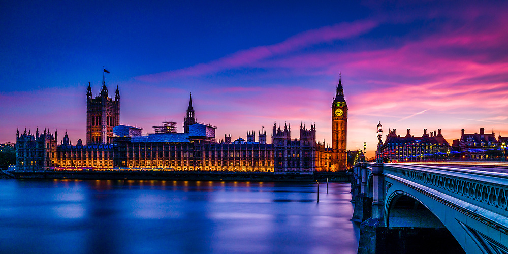 Long exposure image of the Houses of Parliament taken next to the Westminster Bridge during the Blue Hour.