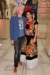 """Philip Treacy and Salma Hayek at the opening of """"Frida Kahlo: Making Her Self Up"""" Exhibition at the V&A Museum, London England. 13 June 2018."""