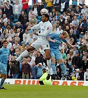 Photo: Kevin Poolman.<br />Milton Keynes Dons v Tranmere Rovers. Coca Cola League 1. 29/04/2006. Dons' Clive Platt beats Gareth Roberts to the ball.