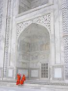 Two women in orange Burkas at the Taj Mahal, Agra