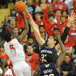 Notre Dame Fighting Irish forward Mike Broghammer (33) blocks a shot by Rutgers Scarlet Knights guard Eli Carter (5) during Big East NCAA action during Rutgers' 65-58 victory over Notre Dame at the Louis Brown Athletic Center in Piscataway, N.J.