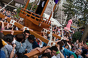 Festival workers carry mikoshi or portable shrines featuring a large iron phallus in the grounds of Wakamiya Hachiman gu shrine during the Kanamara matsuri, Kawasaki Daishi, Japan April 5th 2009