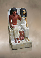 Ancient Egyptian statue of Pawer and his wife Mut, New Kingdom, 18th Dynasty, (1480-1390 BC), Thebes Necropolis. Egyptian Museum, Turin. Drovetti collection. Cat 3057.<br /> <br /> Between the two adults is their son Samut in childhood nudity. The text specifies that the statue was commissioned by Mut. .<br /> <br /> If you prefer to buy from our ALAMY PHOTO LIBRARY  Collection visit : https://www.alamy.com/portfolio/paul-williams-funkystock/ancient-egyptian-art-artefacts.html  . Type -   Turin   - into the LOWER SEARCH WITHIN GALLERY box. Refine search by adding background colour, subject etc<br /> <br /> Visit our ANCIENT WORLD PHOTO COLLECTIONS for more photos to download or buy as wall art prints https://funkystock.photoshelter.com/gallery-collection/Ancient-World-Art-Antiquities-Historic-Sites-Pictures-Images-of/C00006u26yqSkDOM