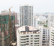HAIKOU, CHINA - AUGUST 19: (CHINA OUT) <br /> <br /> Photo shows a three-storey villa built on a 19-storey residential block on August 19, 2013 in Haikou, Hainan Province of China. There are two families living on the 20th floor, and they both have property ownership certificates.<br /> ©Exclusivepix