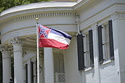 6/28/2020 Jackson MS. <br /> Pictured is the Mississippi Governor Mansion flying the Confederate flag before  the historic vote to remove the Confederate Flag. Mississippi is the only State in the nation that has the Confederate symbol still on its flag. HB 1796 cleared the House and Senate clearing the way to remove the Confederate flag as the state flag for the State of Mississippi.   The Mississippi State legislators gathered at the State Capitol Sunday for a historic vote on HB1796. The MS House of Representatives  passed the Bill 91-23 and the MS Senate voted 31-14 in favor of changing the flag. The Bill would allow for the redesign of the Mississippi State Flag, the current flag has the Confederate symbol on it. Mississippi is the last State in the Nation to still have the racist Confederate symbol on its state flag. Black Lives Matter advocates celebrated the historic vote outside the Capitol. The Mississippi House of Representatives passed the Bill and so did the Mississippi Senate, Governor Tate Reeves said he would sign it if it passed. Photo © Suzi Altman