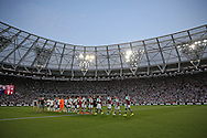 a General view of London Stadium, Queen Elizabeth Olympic Park as both teams shake hands before k/o. UEFA Europa league, 1st play off round match, 2nd leg, West Ham Utd v Astra Giurgiu at the London Stadium, Queen Elizabeth Olympic Park in London on Thursday 25th August 2016.<br /> pic by John Patrick Fletcher, Andrew Orchard sports photography.