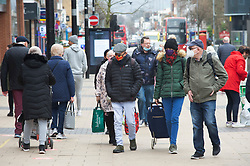 © Licensed to London News Pictures 22/02/2021.        Bexleyheath, UK. Shoppers in Bexleyheath, South East London today during a third national coronavirus lockdown. Non-essential shops and schools could open in weeks if the Covid-19 infection rate keeps dropping. Photo credit:Grant Falvey/LNP