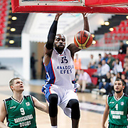 Anadolu Efes's Stephane Lasme (C) and Darussafaka Dogus's Bekir Yarangume (L) during their Turkey Cup First Leg match Anadolu Efes between Darussafaka Dogus at Kadir Has Arena in Kayseri Turkey on Monday 06 October 2014. Photo by Aykut AKICI/TURKPIX