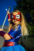 A young girl of seven in a spiderwoman costume
