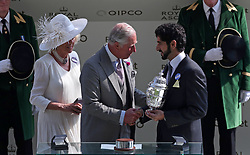 The Duchess of Cornwall and Prince of Wales present a trophy to Sheikh Hamdan bin Mohammed al Maktoum during day one of Royal Ascot at Ascot Racecourse.