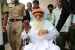 April 25, 2018 - FILE - An Indian spiritual guru who claims to have millions of followers worldwide has been found guilty of rape. A court in the northern city of Jodhpur ruled that ASARAM BAPU raped a 16-year-old girl in 2013 at his ashram there. He is likely to appeal against the verdict in a higher court. The guru, who is 77, has 400 ashrams around the world where he teaches meditation and yoga. PICTURED: May 2, 2016 - Jodhpur, Rajasthan, India - Spiritual leader Asaram Bapu accused in a sexual assault case arrives on wheel chair at the district session court for hearing. (Credit Image: © Sunil Verma/Pacific Press via ZUMA Wire)
