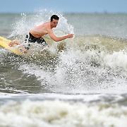 Thomas Joyner, 25, of Hilton head Island, rides a wave off of Burkes Beach on Hilton Head Island on August 25, 2014.  To watch a video, go to:http://bit.ly/1gf1c6W