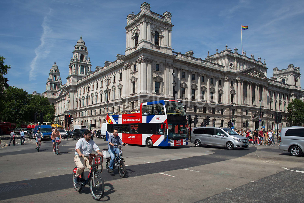 A tour bus with The Original Tour latest branding of a Union jack flag drives through Parliament Square, on 7th July 2017, in central London.