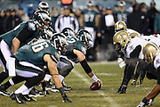 The Philadelphia Eagles offensive line gets set to snap the ball at the line of scrimmage opposite the New Orleans Saints defense during the NFL NFC Wild Card football game against the New Orleans Saints on Saturday, Jan. 4, 2014 in Philadelphia. The Saints won the game 26-24. ©Paul Anthony Spinelli