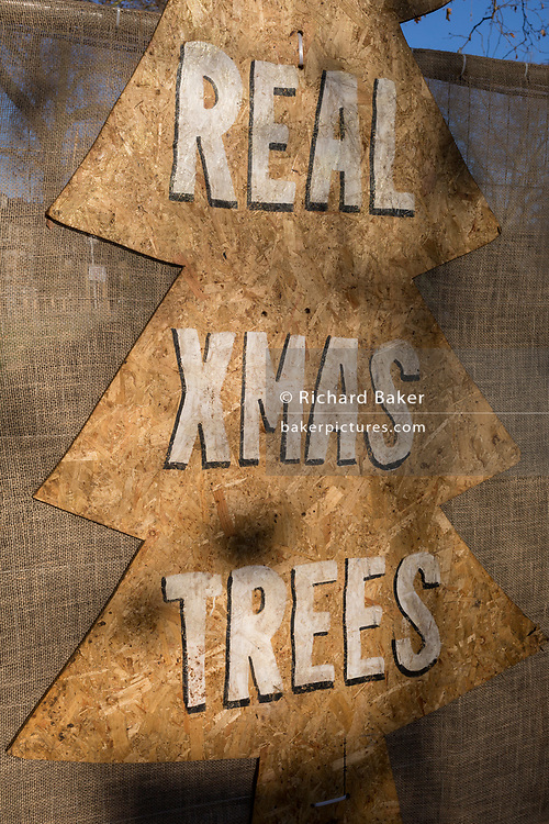 An detail of a Christmas Tree sign of a business pun called 'Tree Amigos' on Goose Green in East Dulwich, in south London, England, on 4th December 2019.